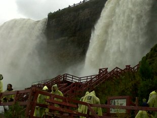The brown foam below Niagara Falls is a natural result of tons of water plummeting into the depths below. The brown colour is clay, which contains suspended particles of decayed vegetative matter, mostly from the shallow eastern basin of Lake Erie.